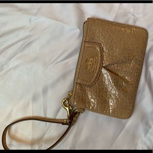 Gold and tan coach wristlet